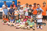 This group of All Stars poses for a picture after a fun day of hitting, running, throwing and eating ice cream at the SaddleBrooke Softball Field; photo by Jim Smith.