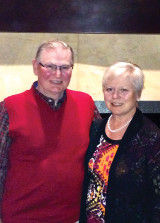 Sandy and Phil Barney, hosts of Montana party