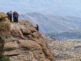 Adventure Club members rapel off a cliff face on Mount Lemmon