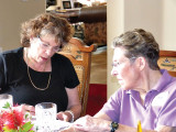 Sigrid Silverman, social chairperson, left, and Gretchen Kolsrud confer on plans for the May picnic at the April luncheon.