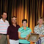 2014 winner Donna Barnard accepting trophy from Pros Ken Steinke and Mike Jahaske with 2013 winner Ann Martin
