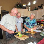 Jack Grech and Duane Waldo help Al Rhodes with tortilla soup preparation