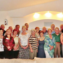 British Club members enjoy wine and cheese at the Taylor home.