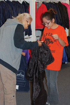 A young lady gets a new windbreaker; photo by Nan Nasser.