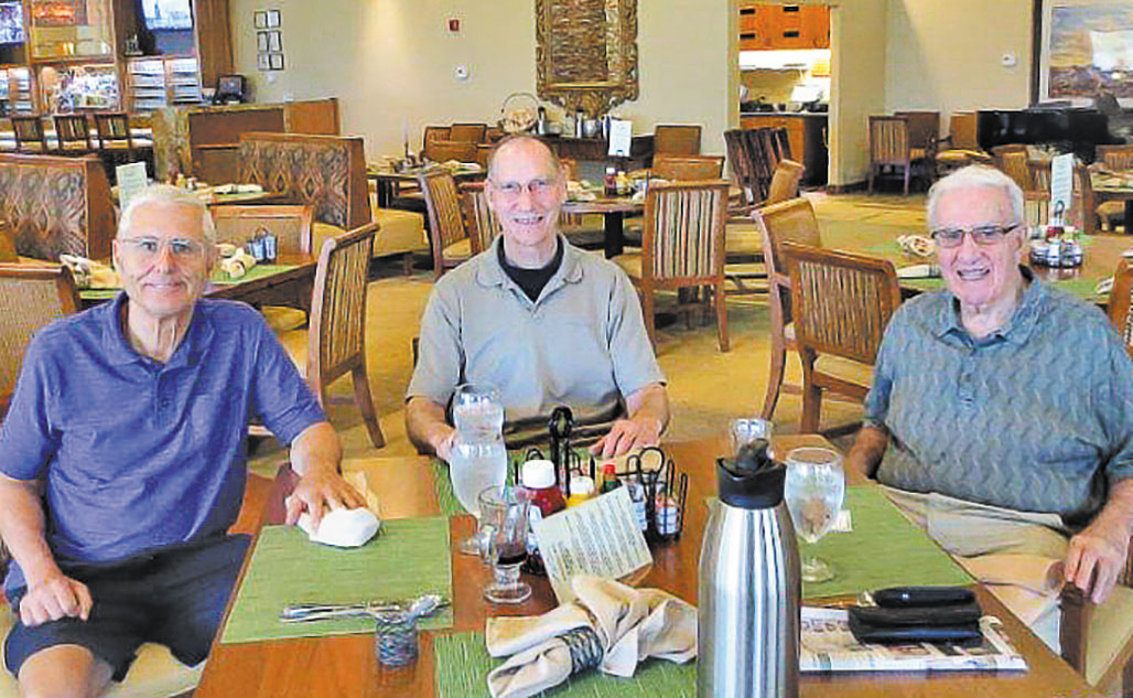 The Men's Bible Study enjoy breakfast together.