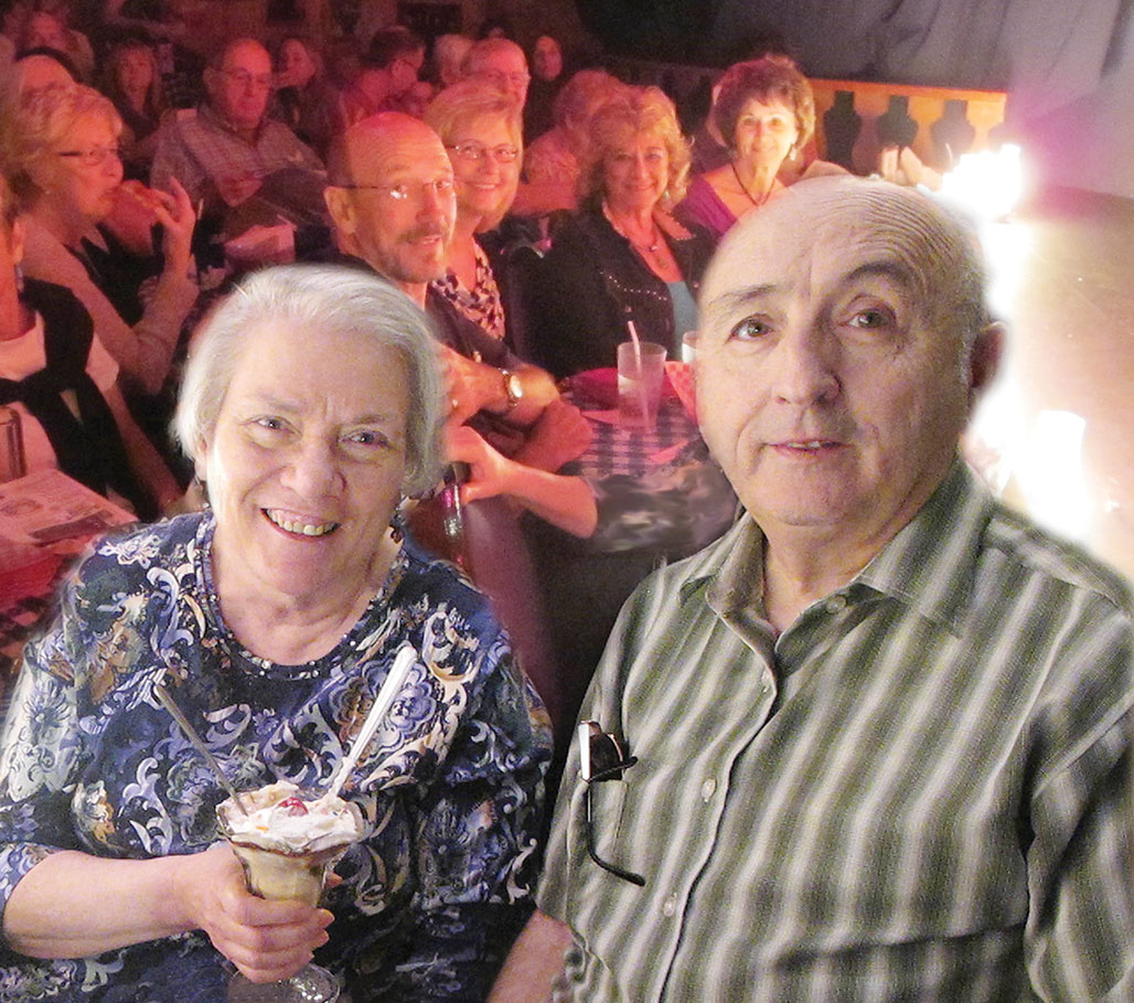 Meg Rau, with husband Jim, enjoys a gift sundae from Gaslight Theater for organizing the trip. Some others also enjoying front row seats are Daniel and Renee Beste, co organizers; Vicky Coletti and Jerry and Dana Parker.