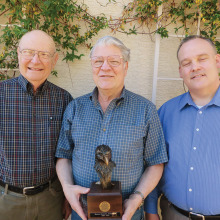 Flanked by Golden Eagles chair John Wiley (left) and Catalina Council Executive Ken Tucker, Roger Bogard holds his bronze eagle awarded to him by his colleagues.