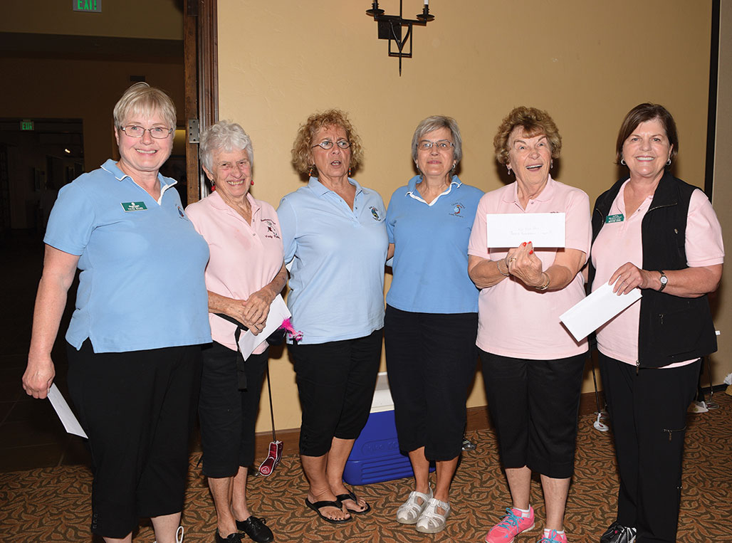 Winners one of two: SaddleBrooke winners from left (wearing pink) are Ruth Catalinotto, Roberta Wisniewski and Bonnie Cook. The ladies in blue are the Quail Creek Putters.