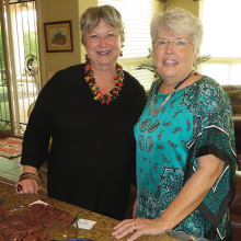 Karen Hustad (left) and Judy Stanard (right) co-hosted the Resurrection Church at SaddleBrooke women's group social on November 14.