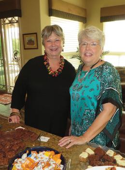 Karen Hustad (left) and Judy Stanard (right) co-hosted the Resurrection Church at SaddleBrooke women's group social on November 14.