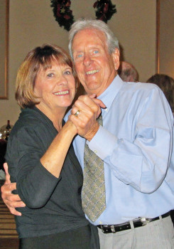 Dick and Mary Clark dancing at the Unit Holiday Party; photo by Ron Talbot