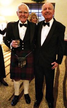 Tom Killoran informs Phil Williams on proper kilt attire.