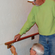 Dave Smith (left) and Dan Linegar attach a rail.