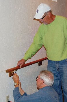 Dave Smith (left) and Dan Linegar attach a rail.