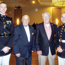 Marines honored at the dinner dance, left to right: Marine Captain Zachary Knight, Military Food Banks Chair Moose Creighton, STS President George Bidwell and Marine First Sergeant Jason Hamm.