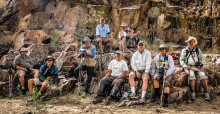 Aravaipa Canyon hiker/photographers, front: Dick Kroese, Ron Taylor, Doug Armstrong, Bob Shea, Kent Banta, Richard Spitzer and Byron Cotter; back Dan Garand, Bill Todd and Connie Sparbel; photo by Bob Shea