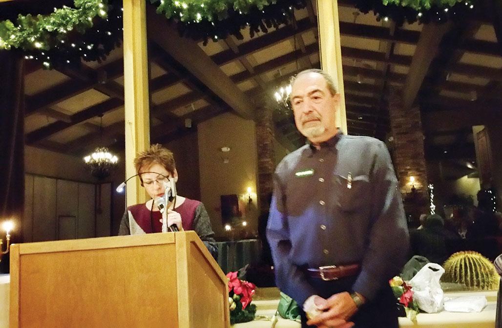 Carol Gordon thanking Seth Basker for his work as president