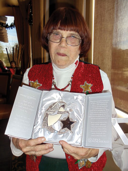 MVLP Em Anderson: Emily Anderson receives angel ornament for years of dedicated service to MVLP.