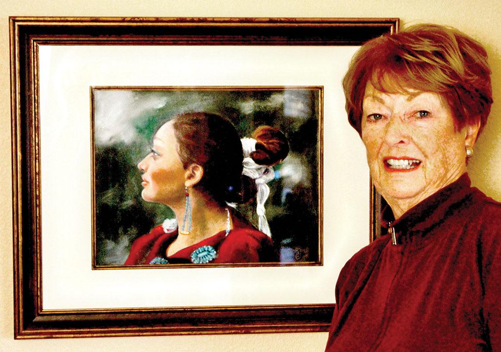 Barbara Cox with her painting, Navajo Princess