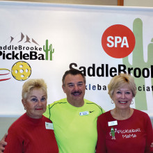Left to right: Assisted Play Coordinator Lois Violant, Demo Day and Introductory Lessons Instructor Bob Kosmo Kramer and Membership Chair for SPA Joni O'Brien. These three dedicated volunteers get ready to welcome SaddleBrooke residents to the Pickleball Table at the Recreation Activities Fair that took place Saturday, January 24 at the MVCC.