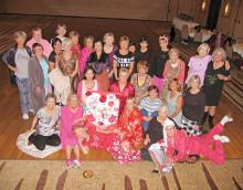 The SaddleBrooke Line Dancers share secrets in their pj's.