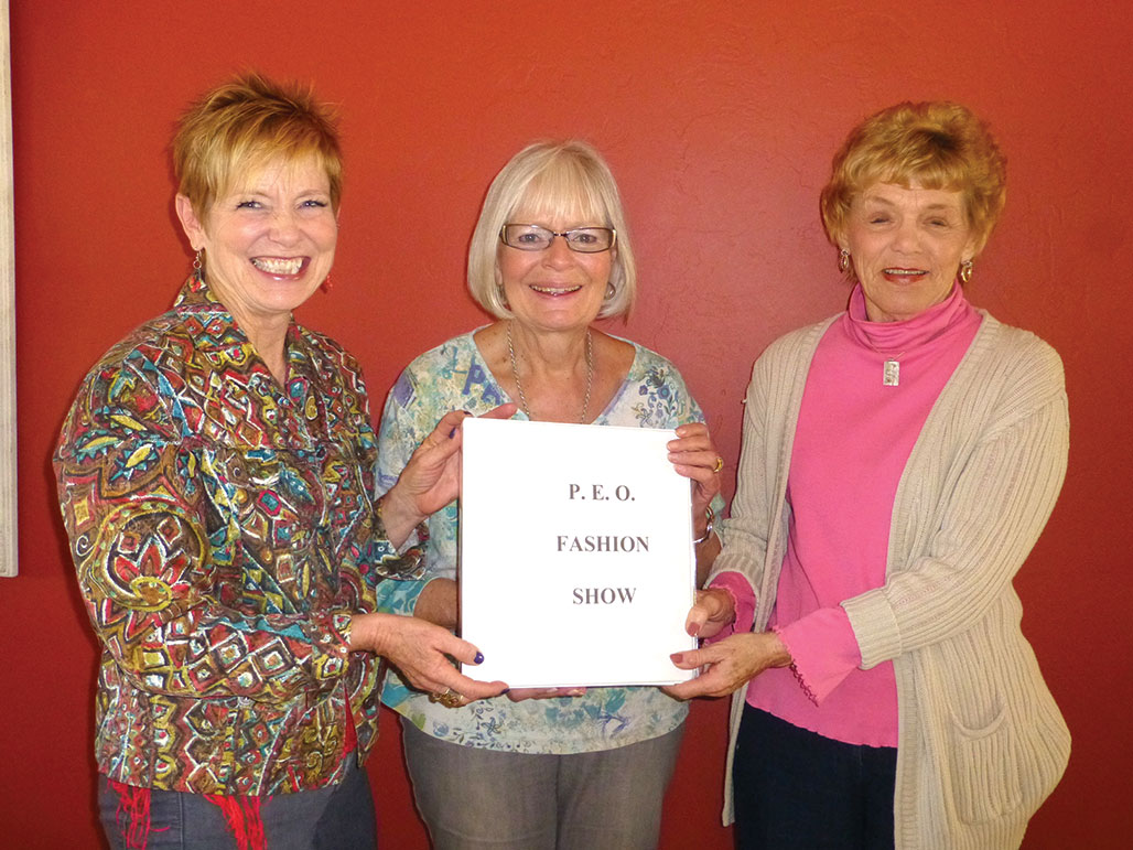 Dianne Ashby passes the reins to Mary Baglien and Vicki Graham who will co-chair next year's event.