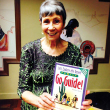 Doris Evans with her book, Let's Explore the Desert Go Guide.