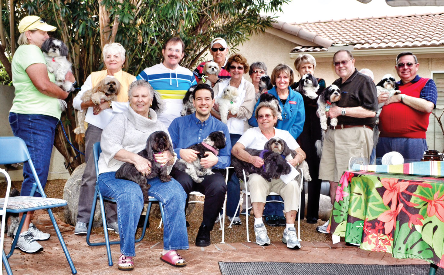 The Shih Tzus brought their owners to hear Dr. Dimitri Brown.