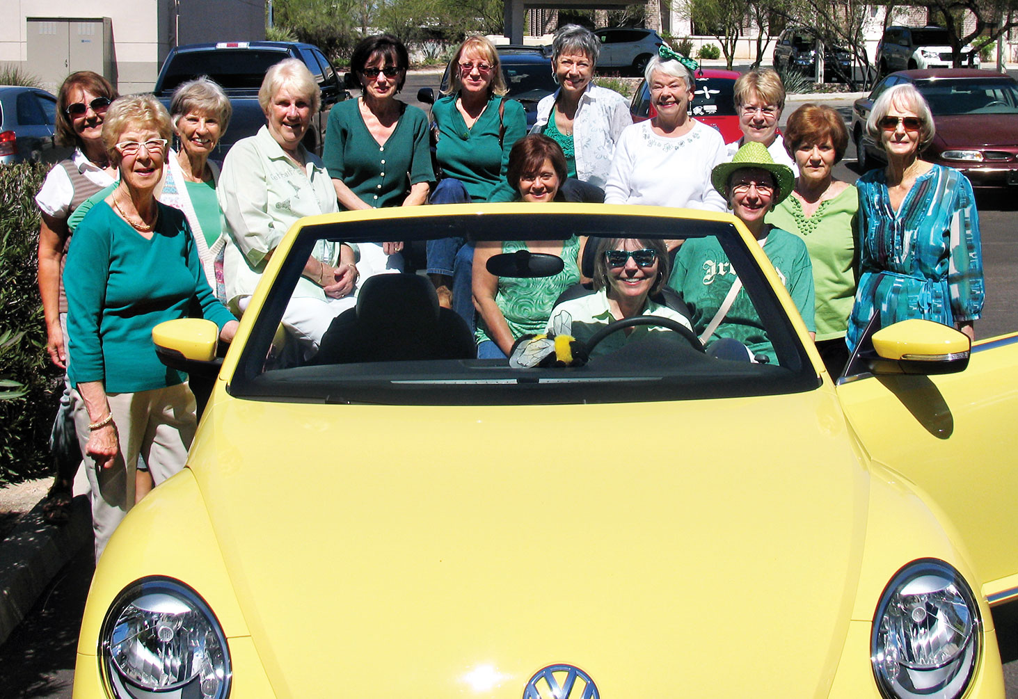 SaddleBrooke Line Dancers try to squeeze into a Volkswagen Beetle.