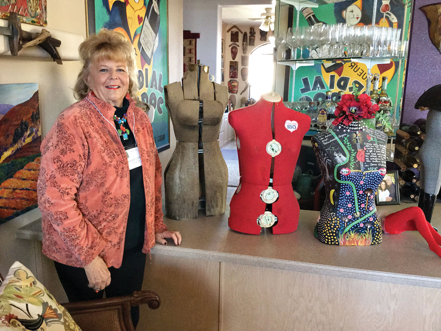 Marianne Lyons with some of her decorated, antique dress forms.