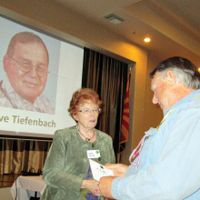 Christine Nelson presents Randy Gibbs with his door prize.