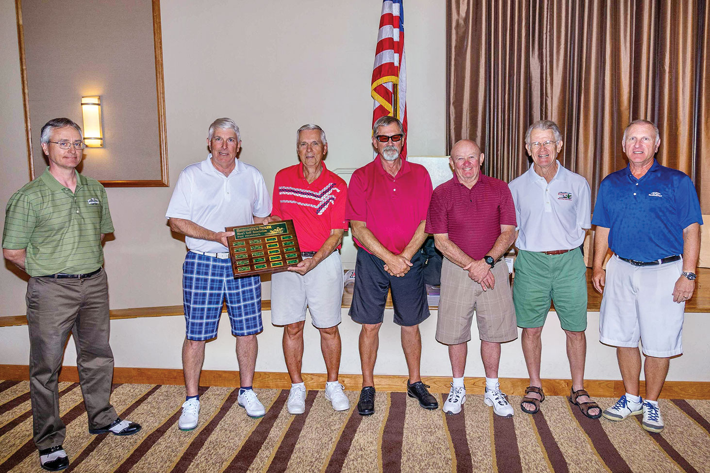 Mike Jahaske and past presidents Jon Michels, Chuck Kelsey, John Borchert, Tom Pryde, Ed Koch and current President Dennis Marchand receiving the plaque