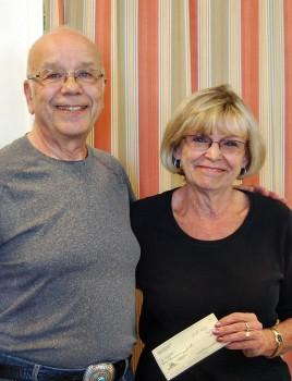 Arthur Posner gives check to SBCO President Joan Roberts