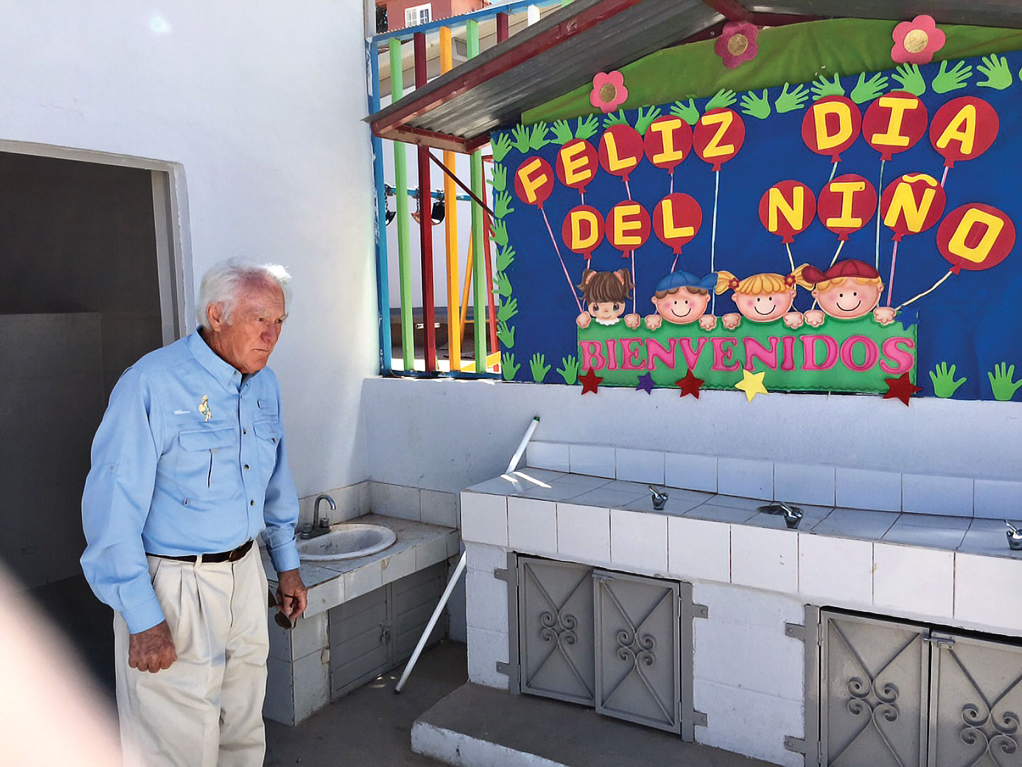 John with our first purified drinking fountain installed in Nogales