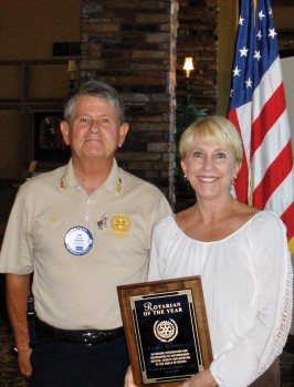 Rotary Club of SaddleBrooke President Jim Lamb awards Linda Turbyfill with the Rotarian of the Year honor.
