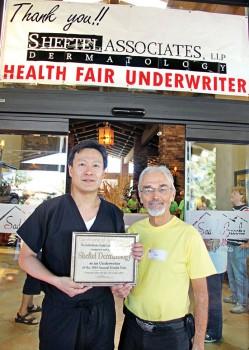 Ken Siarkiewicz, Health Fair Chair, presents a certificate thanking Sheftel Healthy Skin for underwriting the Health Fair.