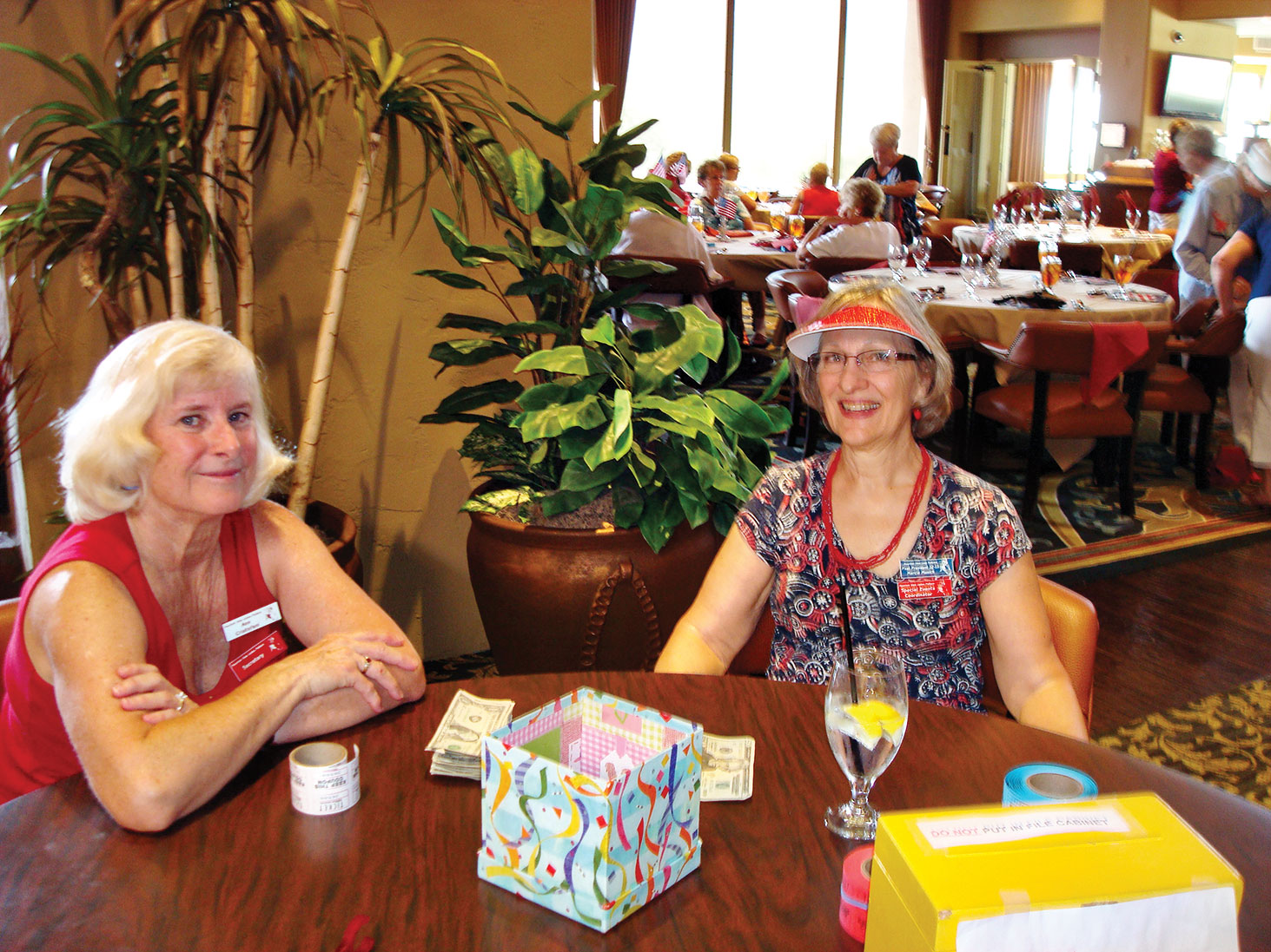 Ann Cristofani and Marcia Munich greet MVLPutters at the July luncheon.