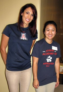 University of Arizona audiology students are on hand to help fairgoers sign up for free hearing tests.