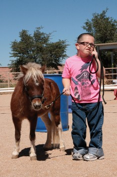 Colton with his adopted horse Scout