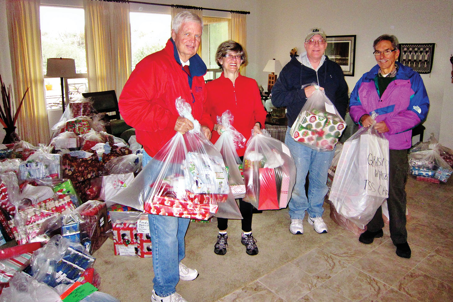 Joe Murdock, Ellen Perkins, David Wisniewski and Sam Carmen are surrounded by gifts for Apache Indian children to be delivered to the San Carlos Reservation.
