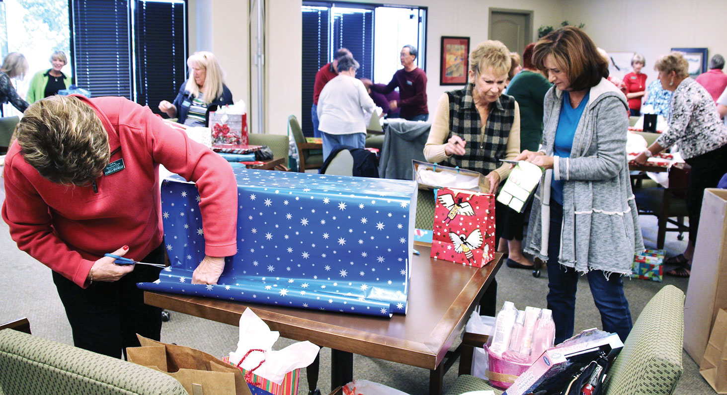 A SaddleBrooke Community Outreach Adopt a Family wrapping party for Unit 49 (photo courtesy of Marge Wong).