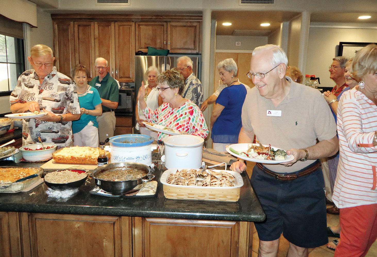 A potluck dinner is enjoyed by many.