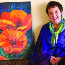 Kathy Borchert's painting, Wild Poppies, textiles blouse and scarf. Photo by J. Cohen