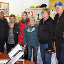 Left to right: Committee members after delivering the gifts and food bags to the school include Peter Bratz, Carol Smith, Marlene Diskin, Judi Cosel-Slavin and Camille and Ken Hovmiller.
