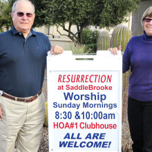 Steve and Marty Harsch with a Resurrection Church sign