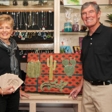 Susan and Jerry Gustafson display the craftsmanship available at the SaddleBrooke Gift Shop.