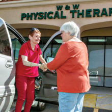 Senior Village volunteer drives member to physical therapy.