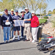 Volunteers gather used equipment at the annual drive.