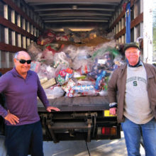 We borrowed the Impact truck in order to deliver presents for 249 Apache children at San Carlos in one trip. Left to right: Truckers Tom Drake, Bruce Fink, Bob Stephens and Dave Wisniewski.