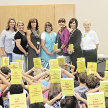 At Wilson Elementary School are (from left): Cathy Mikesell, Rachel McCoy, Debbie Price, Teri Pastor, Chris Champie, Marian Manning and Catalina Mountain Elks Dictionary Project Chairperson Joyce Garcia.